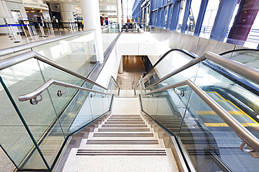 Empty airport interior, concourse and stairs and escalators