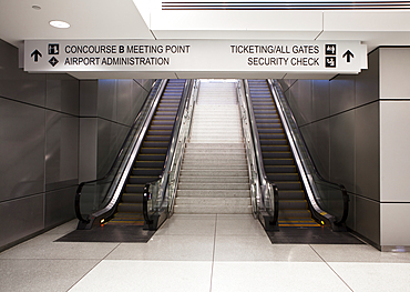 A pair of escalators and information signs