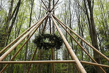 Wooden structure with wreath for a woodland naming ceremony.