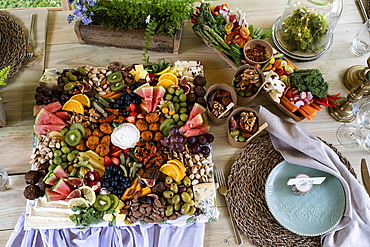 Rustic place setting for a feast and naming ceremony in a forest.