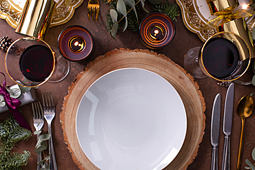 Christmas, a table setting, overhead view, wine and candles, plates and cutlery