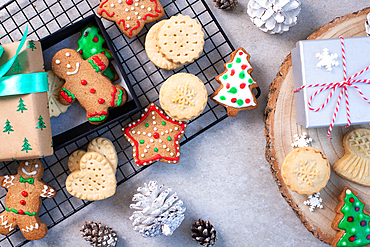Overhead view of Christmas cookies and biscuits, and Christmas ornaments.