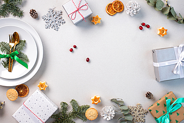 Christmas decorations on a white background, green leaves and red berries