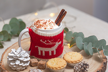 Christmas, mince pies and mug of hot chocolate or eggnog with a knitted wraparound cover