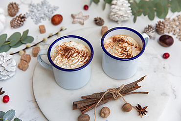 Christmas, mugs of egg nog with whipped cream and candy canes.