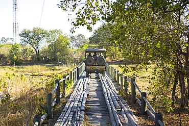 Safari vehicle crossing Fourth Bridge, Okavango Delta, Botswana.