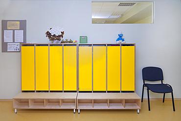 Modern day care nursery or pre-school kindergarten, spacious interiors, lockers and storage