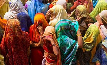 A colourful crowd of people celebrate the Holi Festival, Mathura, Uttar Pradesh, India, Mathura, Uttar Pradesh, India
