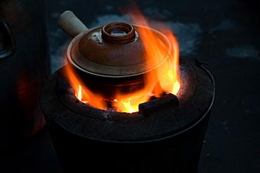 Pot simmering on a small barbeque, Yangon, Myanmar, Yangon, Myanmar