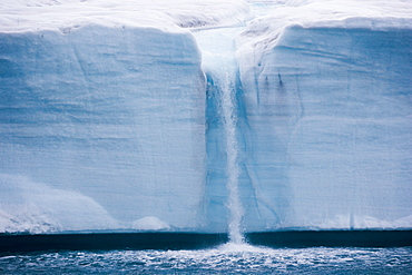 A waterfall is created by a melting iceberg, Svalbard, Norway, Svalbard, Norway