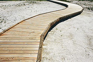 A boardwalk extending across Midway Geyser in Yellowstone National Park, Cle Elum County, Washington, USA