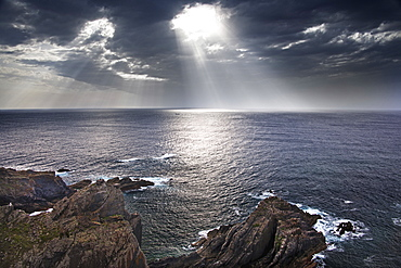 Cabo Sardao coastline in Portugal. Sun streaming through cloud on to the sea, Cabo Sardao, Portugal
