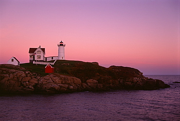 Cape Neddick and the Nubble Lighthouse, on a headland on the Maine coastline at sunset, Cape Neddick Lighthouse, Maine, USA