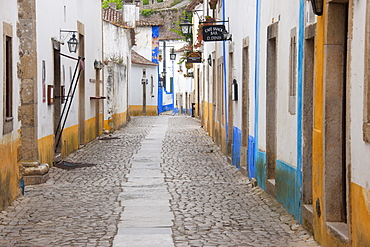 A quiet narrow street of traditional houses in the village of Sonega, Sonega, Portugal