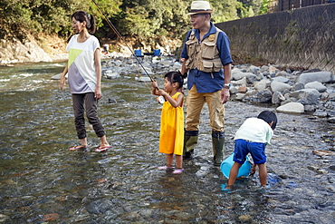 Family fishing in a stream, Kyoto, Honshu Island, Japan