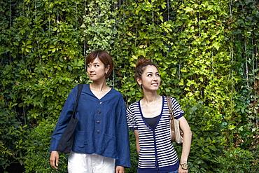 Two women standing side by side, Osaka, Japan
