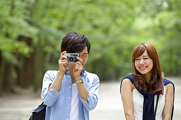 A couple, a man and woman in a Kyoto park, side by side, Kyoto, Honshu Island, Japan