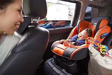 A mother and her young baby boy in a car, Kyoto, Honshu Island, Japan