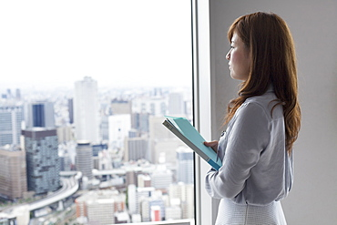 A working woman in an office building, Sakai City, Osaka, Japan