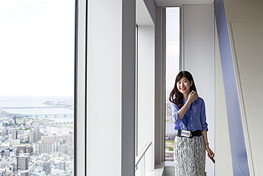 A working woman in an office building, Sakai City, Osaka, Japan