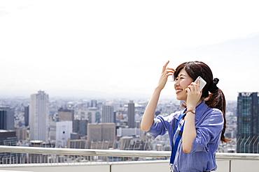 A working woman on a balcony, Sakai City, Osaka, Japan