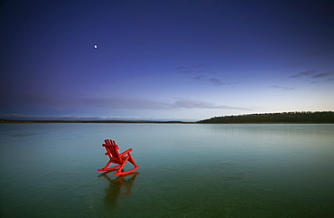 A small red rocking horse, on a frozen lake, Lake, Saskatchewan, Canada