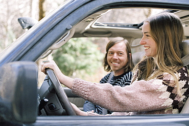 Smiling young couple driving in their car, Millcreek, Utah, United States of America