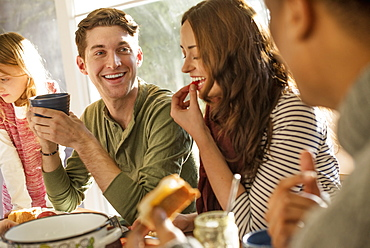 A group of people sitting at a table, smiling, eating, drinking and chatting, Woodstock, New York State, USA