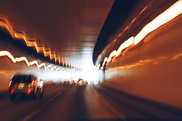 Cars driving through tunnel, long exposure, USA