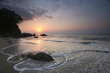 Sunset and a view across a beach and headland in Puerto Vallarta, Puerto Vallarta, Mexico