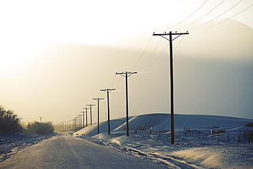 Power lines reaching into the distance, with a mountain backdrop, Hydro Lines, USA