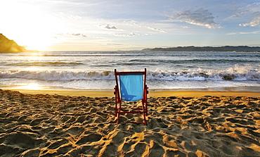 A beach chair on the sand and a sunset on the horizon, Beach, Mexico