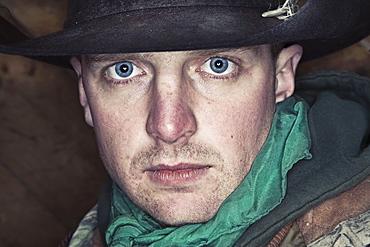 A man with bright blue eyes looking at the camera, Cowboy, Canada