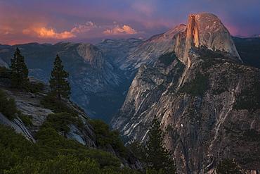View of Half Dome in Yosemite Valley in YosemiteNational Park, California at dusk.