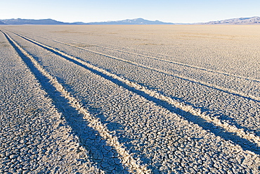 Tire tracks on the dry surface of the desert, Black Rock Desert, Washoe County, Nevada, USA