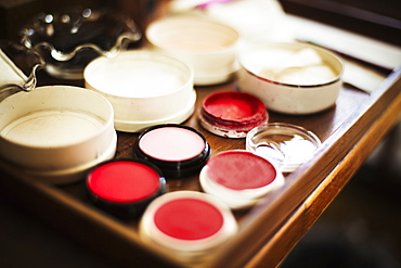 A tray of pots, rice powders, blushers and loose powder used in the white face make up of geisha women, Japan