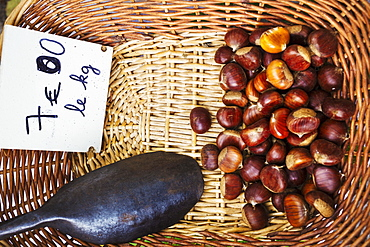 A basket of roasted sweet edible chestnuts, France