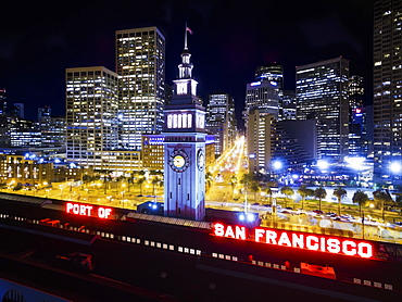 View from the air of the Ferry Building in San Francisco, at night, The city buildings of downtown and the waterfront buildings, New York City, USA