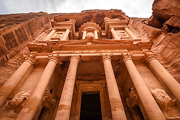 Low angle exterior view of the rock-cut architecture of Al Khazneh or The Treasury at Petra, Jordan, Petra, Jordan