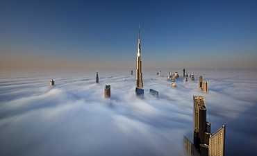 View of the Burj Khalifa and other skyscrapers above the clouds in Dubai, United Arab Emirates, Dubai, United Arab Emirates