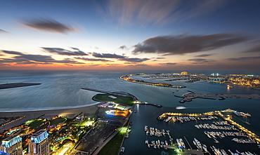 Aerial view of marina and Persian Gulf at dusk, Dubai, United Arab Emirates, Dubai, United Arab Emirates
