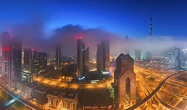 Cityscape with illuminated skyscrapers in Dubai, United Arab Emirates at dusk, Dubai, United Arab Emirates