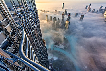 Aerial view of cityscape with skyscrapers above the clouds in Dubai, United Arab Emirates, Dubai, United Arab Emirates