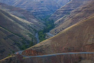 A view from above of a car on the highway in the Grande Ronde scenic area of eastern Washington State, United States of America
