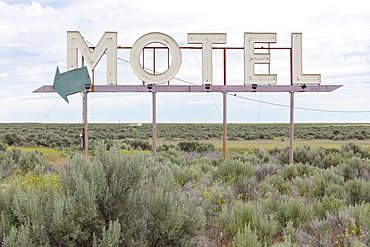 Motel sign in field of sage brush, near Waterville, Washington, United States of America, Washington, United States of America