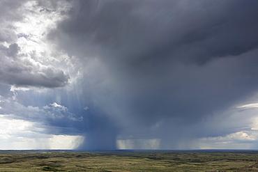 Dark storm clouds of over Grasslands National Park, Saskatchewan, Canada