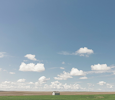 Small barn on vast open prairie, Saskatchewan, Canada
