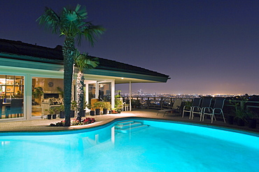 Illuminated pool at night with city in background, Los Angeles, California, United States, Los Angeles, California, United States of America