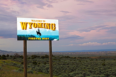 Cowboy on bucking bronco on Welcome to Wyoming sign, Wyoming, United States, Wyoming, United States of America