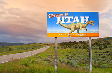 Dinosaur on Welcome to Utah sign along road, Utah, United States, Utah, United States of America